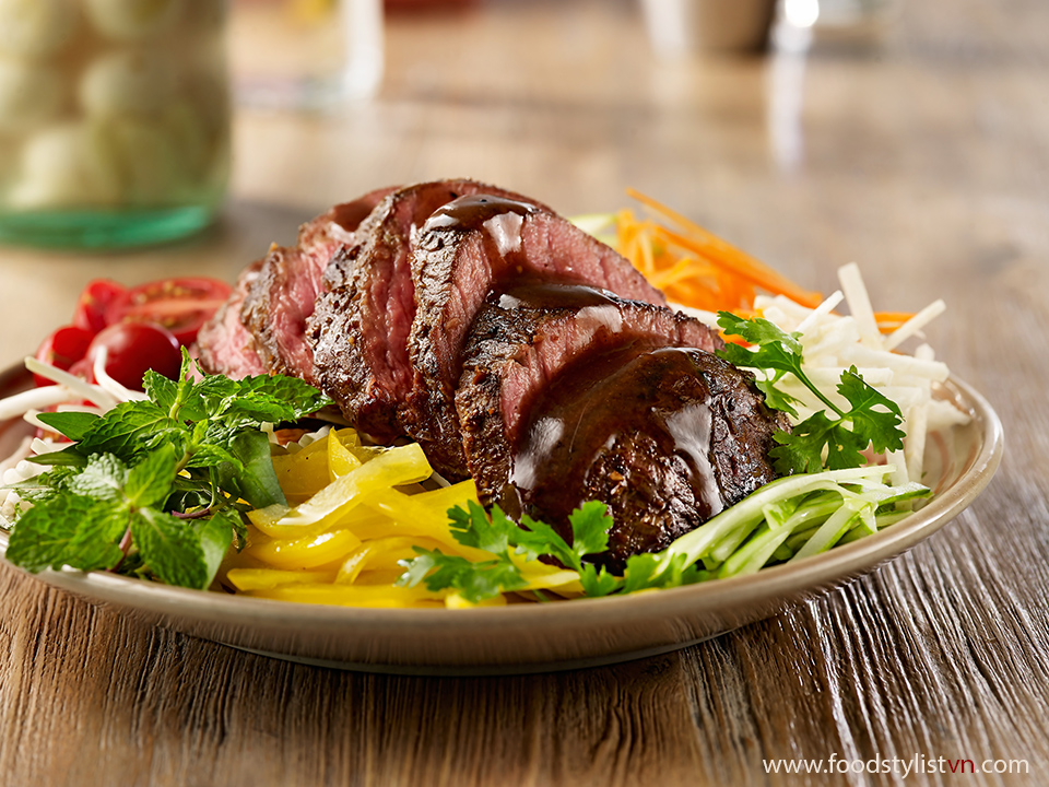 Charred beef salad with lemongrass Client: Phương Nam Book Recipe by: Le chi Photograph by: Wing Chan at BITE Studio Food Stylist: Nguyên Bùi
